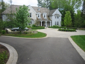 Brick paver border with brick paver circle